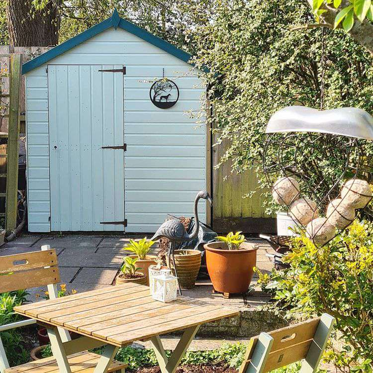Outdoor shed in small garden