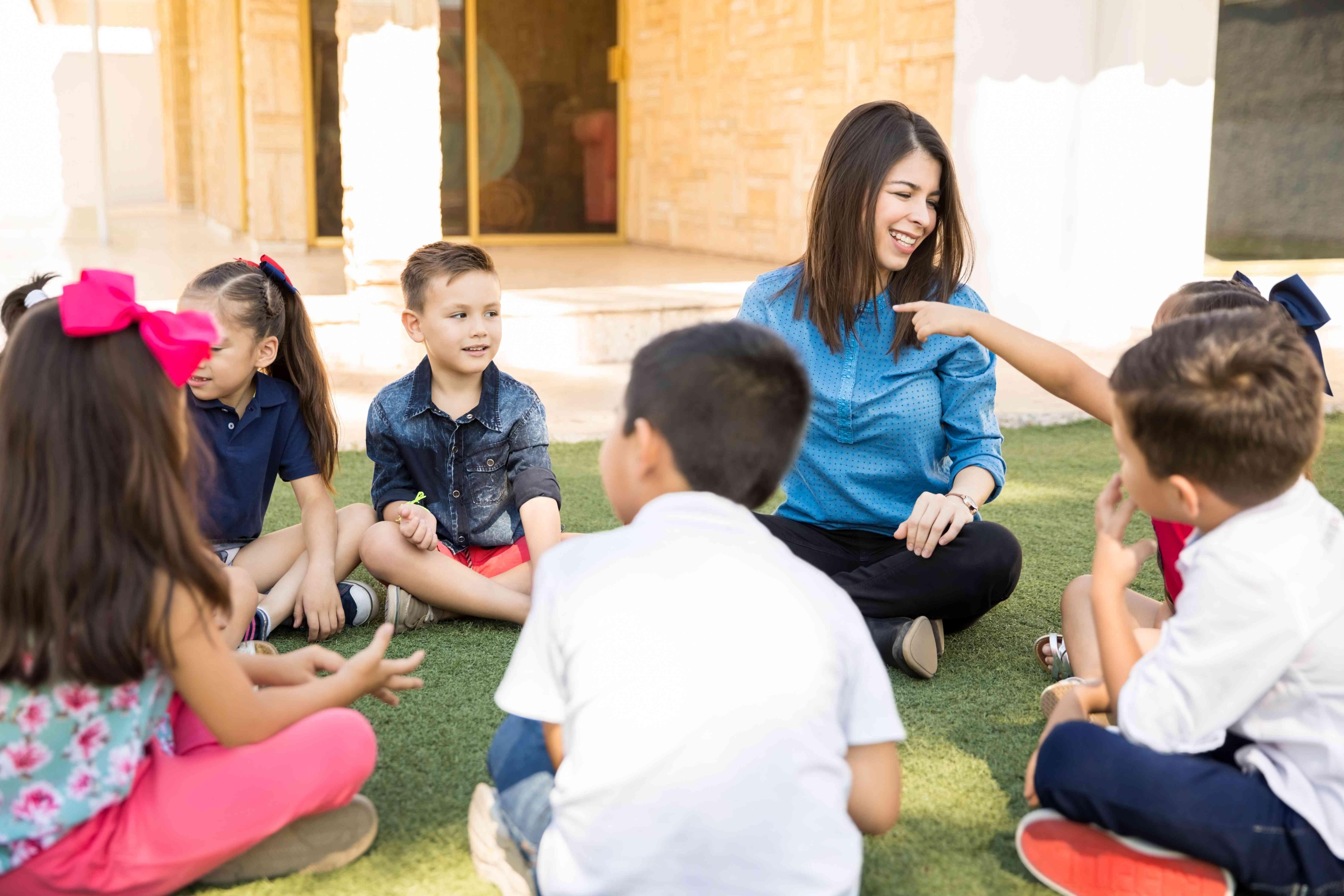 Kids having a preschool class outdoors