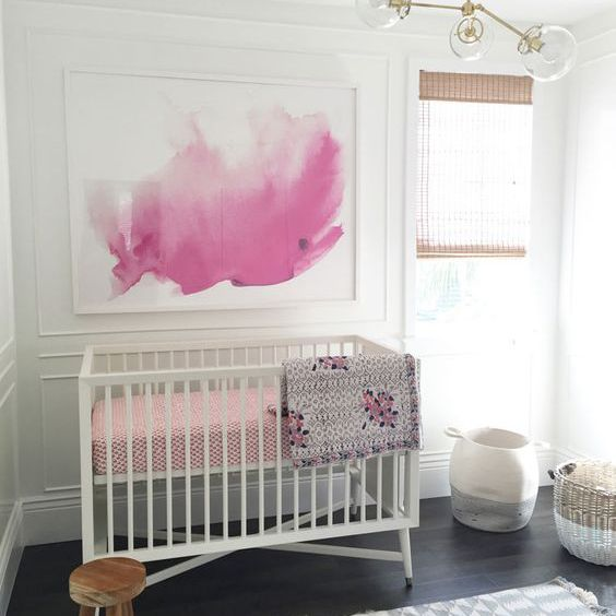 Modern, white nursery with art mural