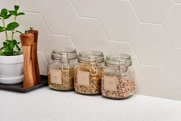 labeled glass canisters for storing bulk items in the kitchen