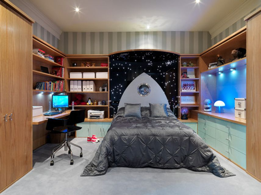 Space-themed kid's room with built-ins