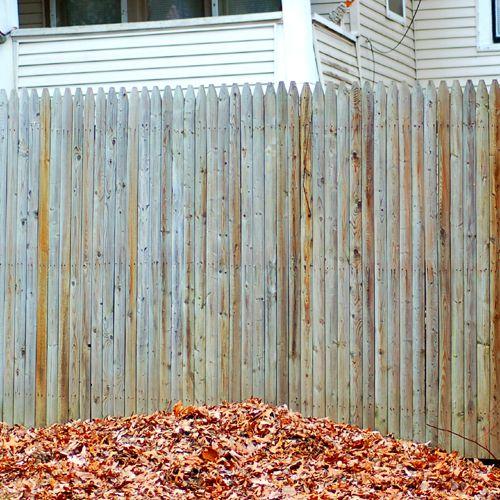 Photo of a stockade fence.
