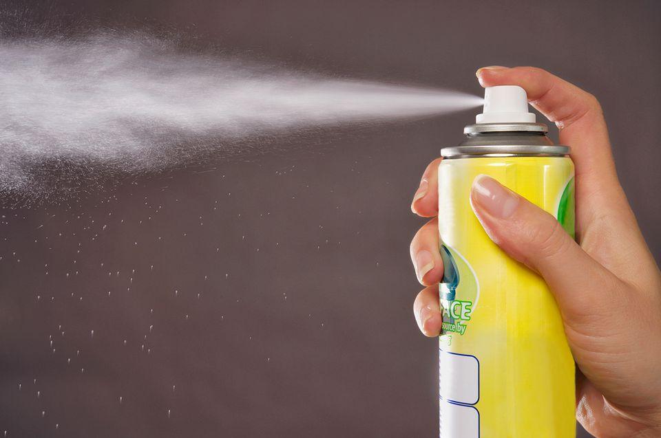 Caucasian Woman Spraying Aerosol Can