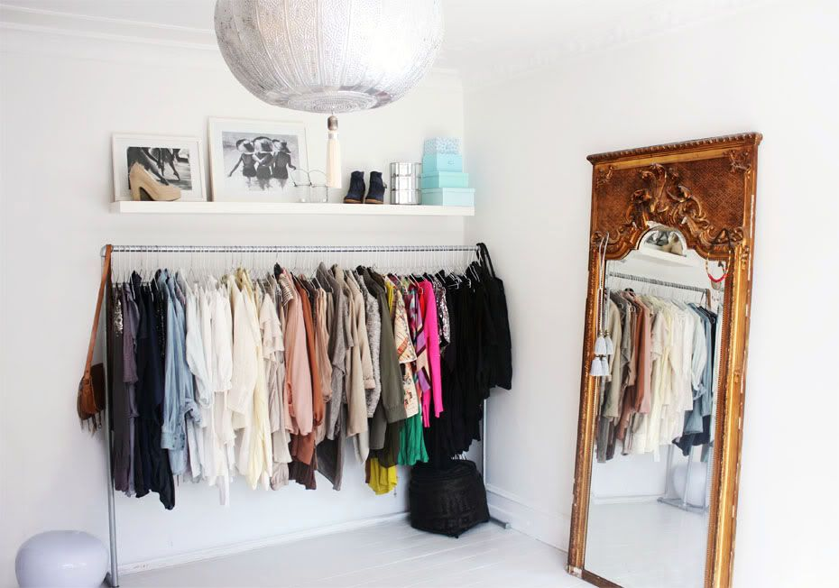room with white walls and a clothes rack