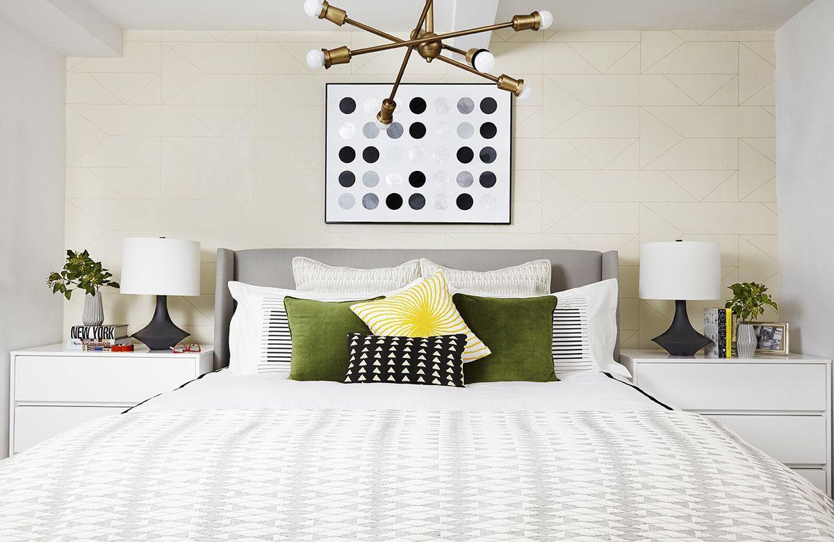Bedroom With Unique Lighting Fixture