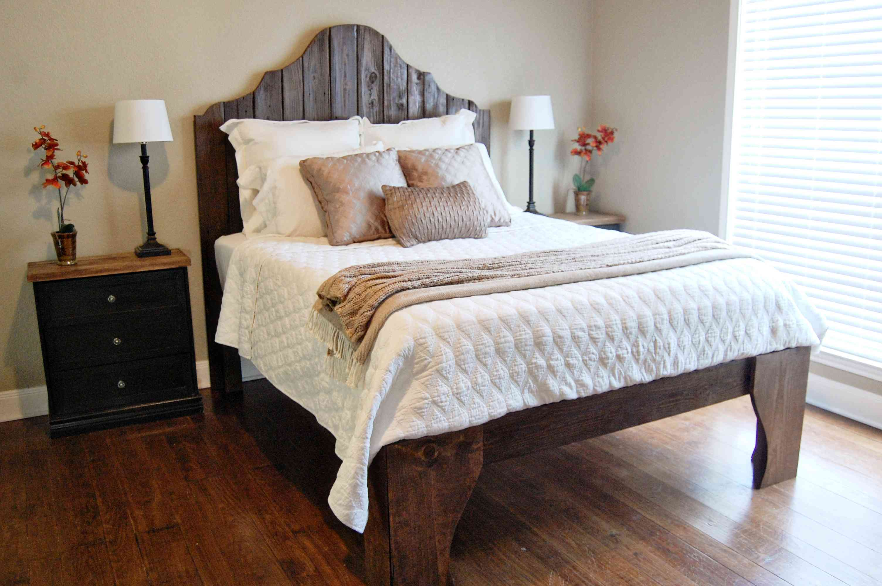 A wooden bed in a bedroom