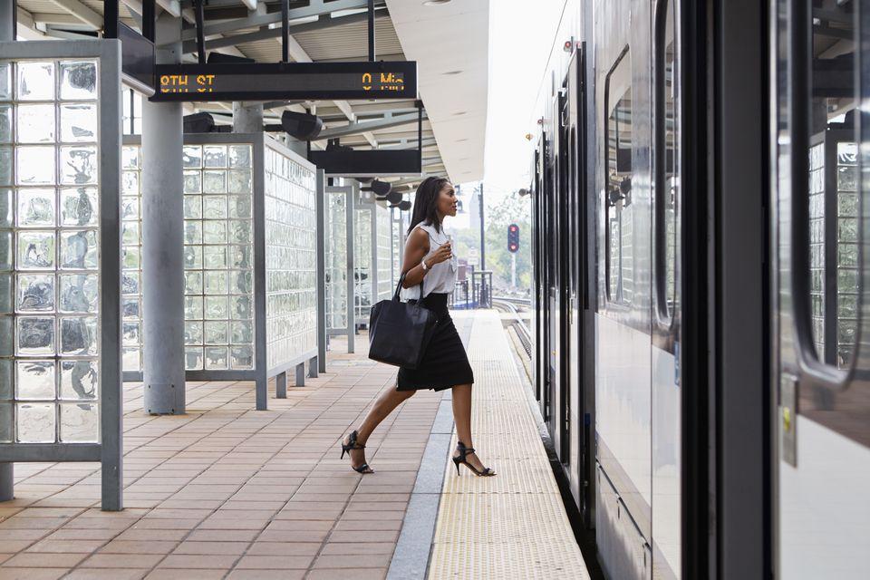 Businesswoman boarding train
