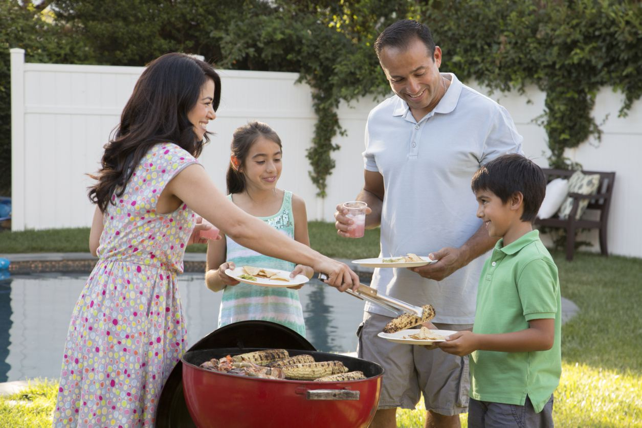 Family having a backyard barbecue