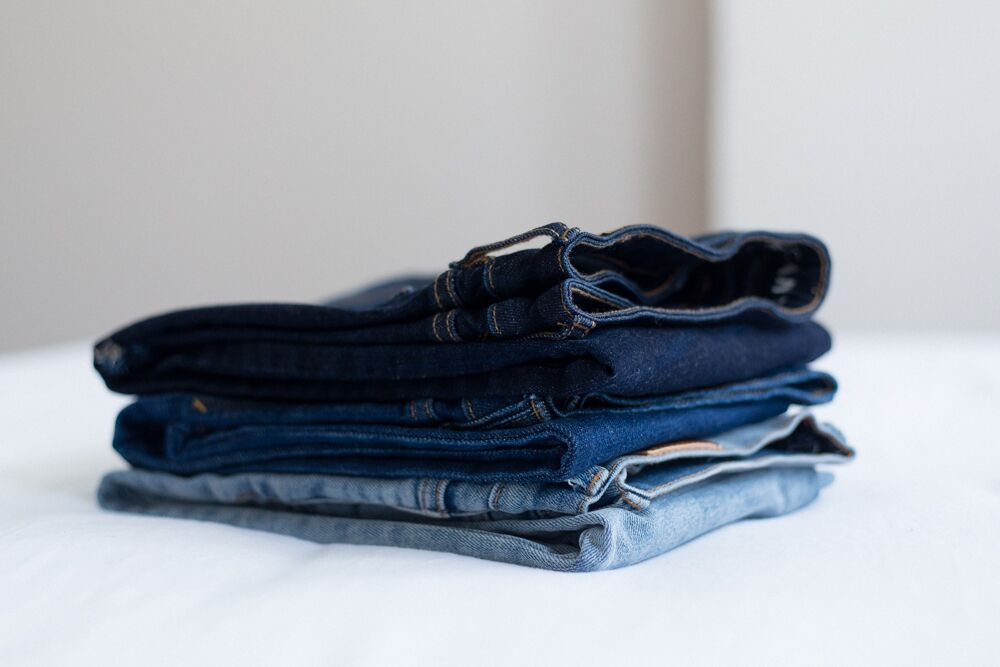 small stack of neatly folded denim