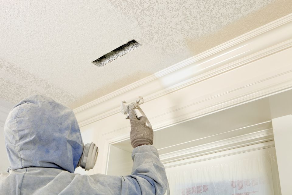 Spray Painting Walls and Crown Molding