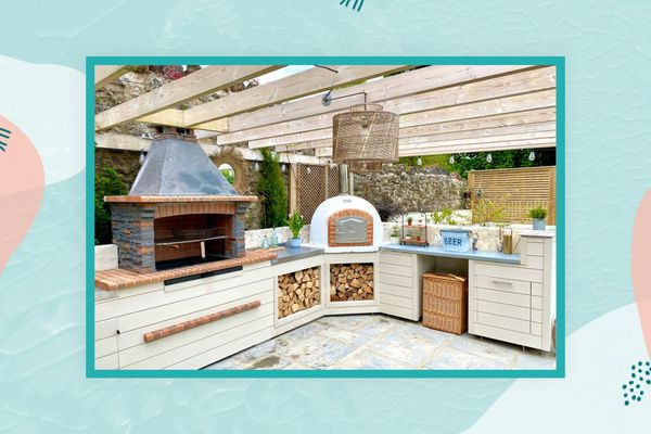 outdoor kitchen with brick oven, pergola and more