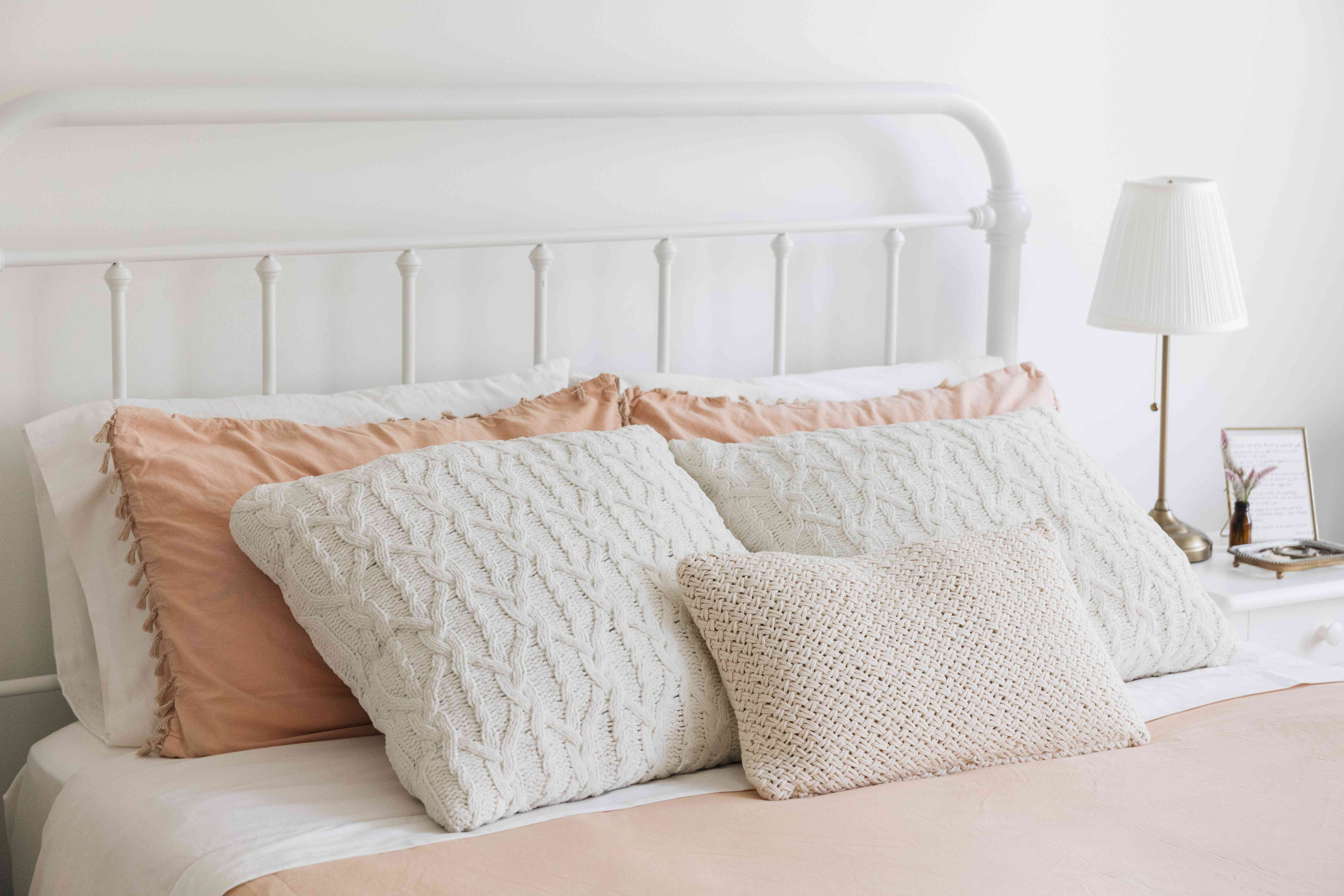 throw pillows arranged on a bed