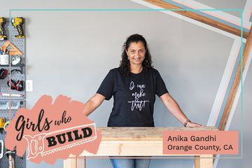 Anika Gandhi poses at a work table for Girls Who Build