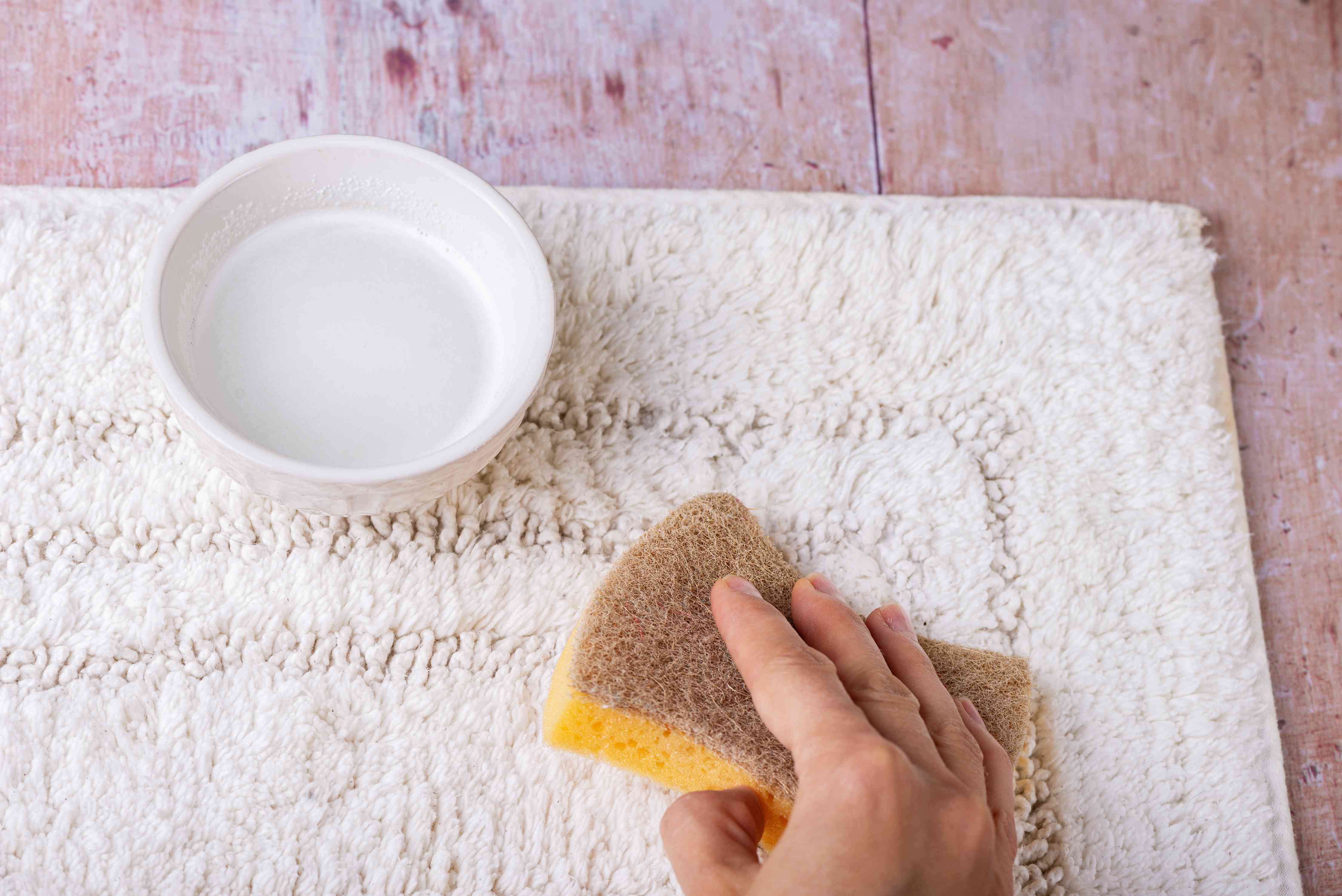 Apply cleaning solution to carpet stain