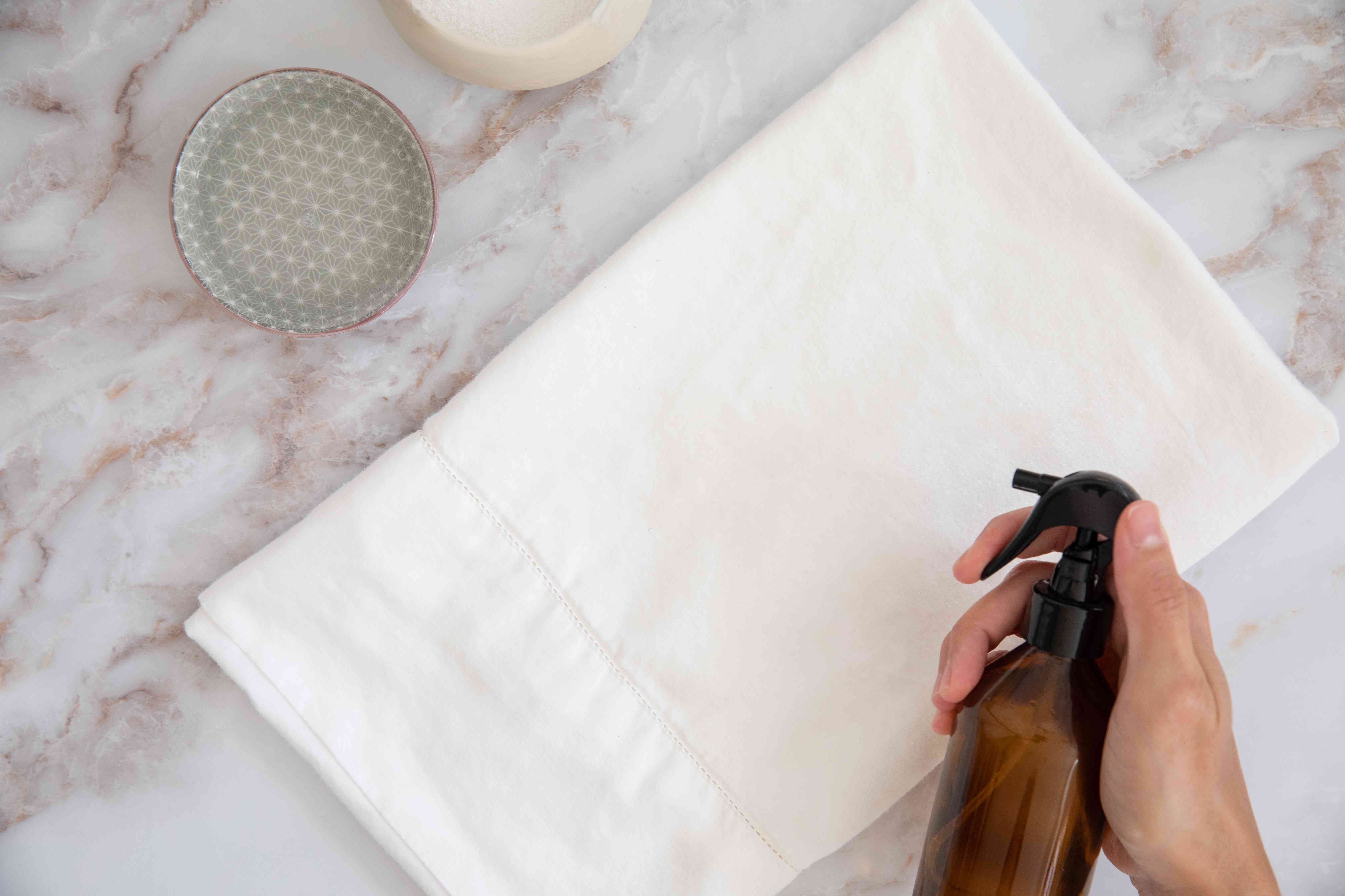 pretreating any stains on bamboo fabric