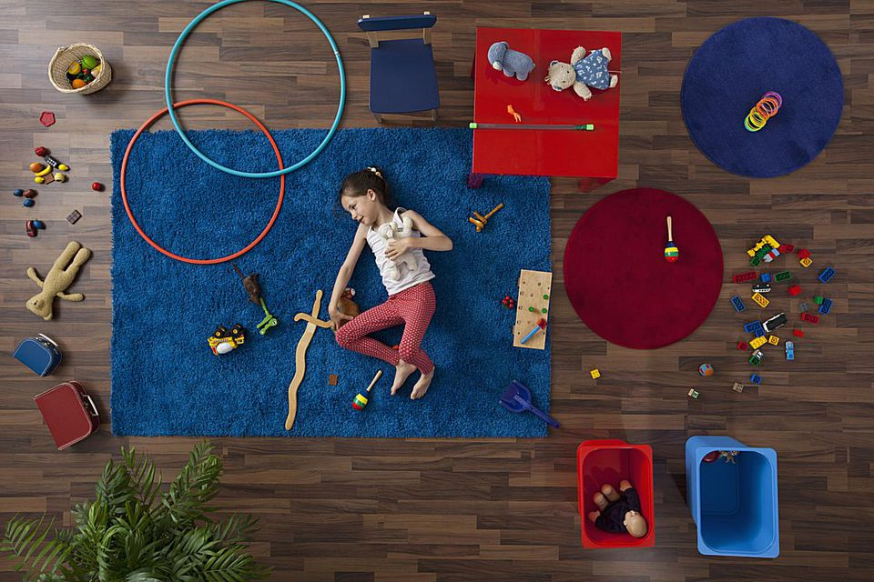 Young girl on floor with toys