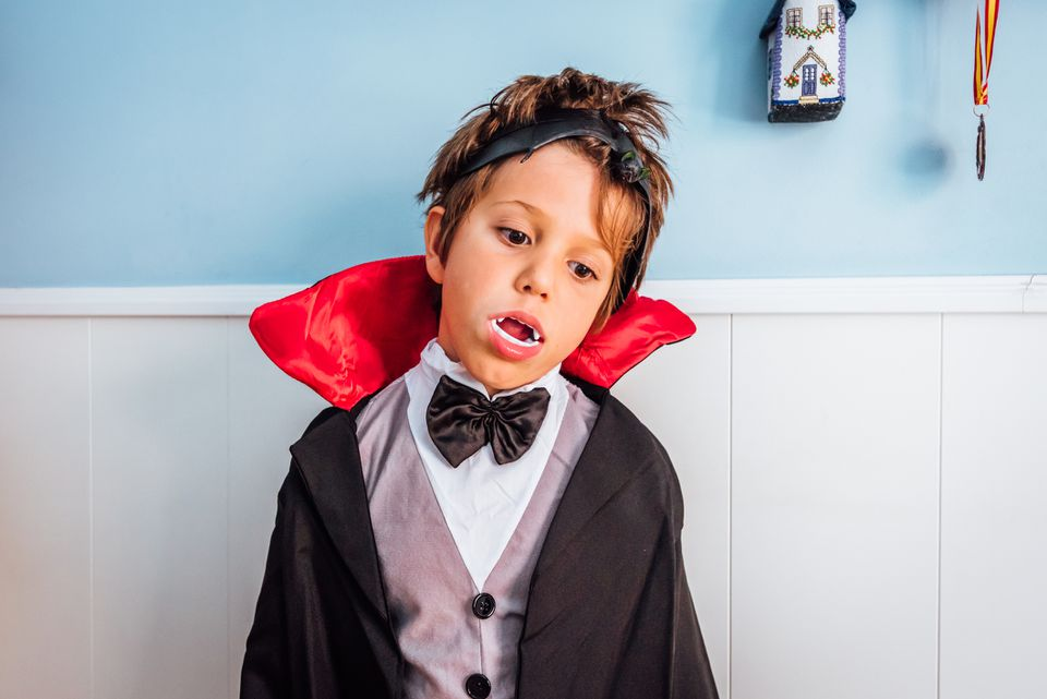 Child disguised as vampire for Halloween