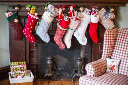 stuffed christmas stockings over fireplace