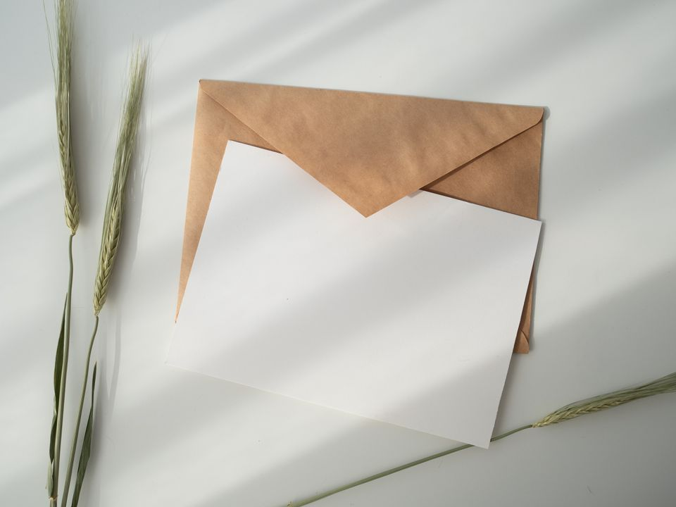 Blank card on top of brown envelope