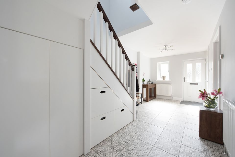 Hallway with staircase storage