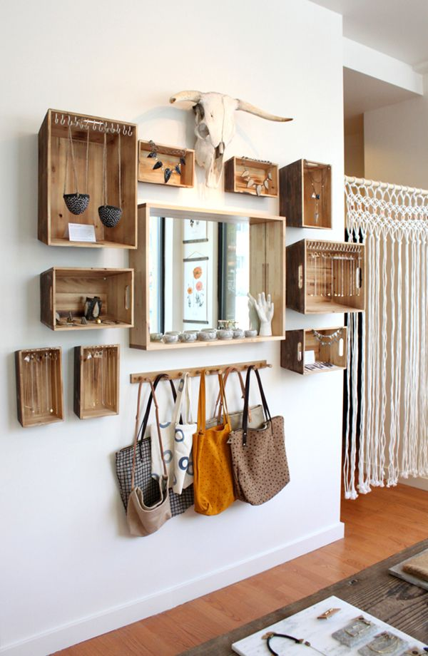 Hanging wooden crates on the wall.