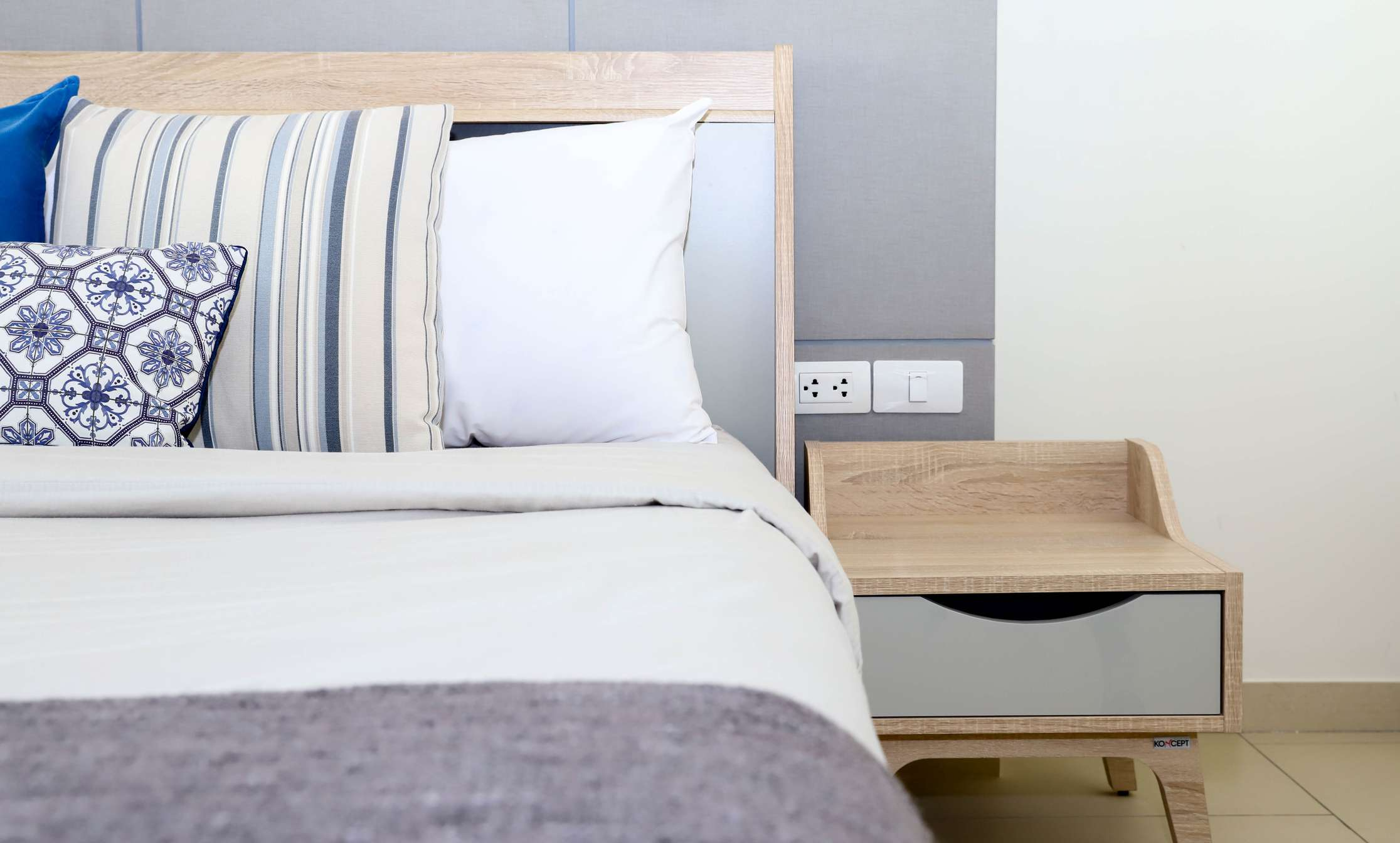A closeup of a bedroom and nightstand