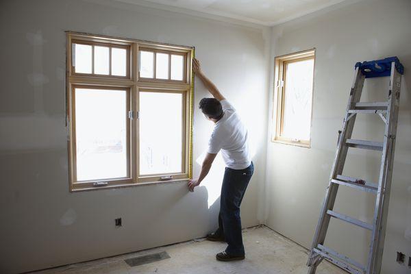 Man measuring window