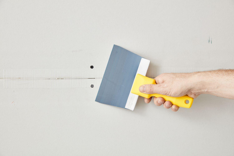 applying fiberglass tape