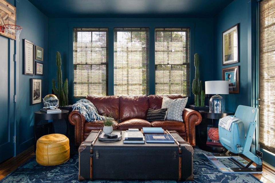 leather sofa with blue walls in den