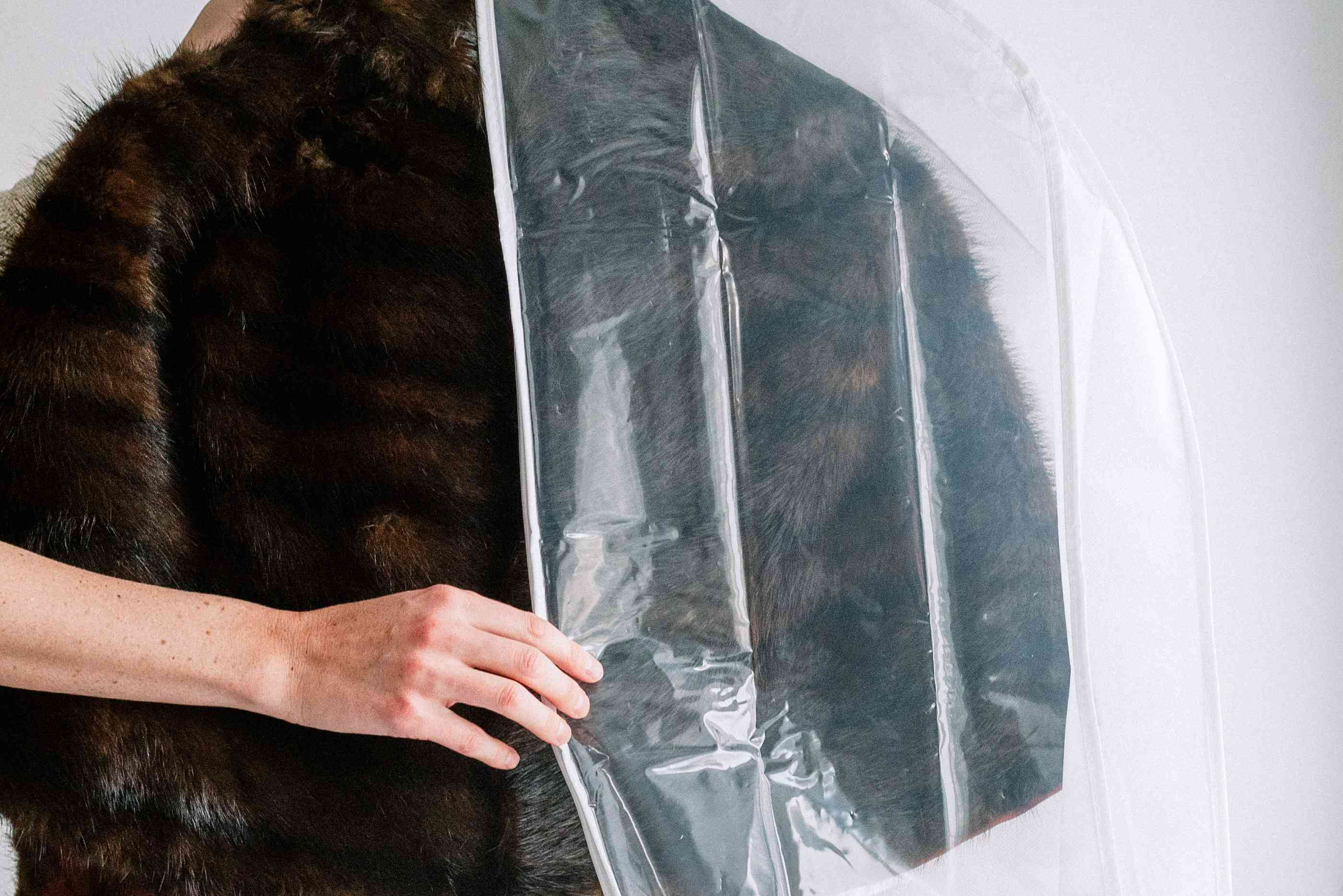 Putting a natural fur coat in a garment bag