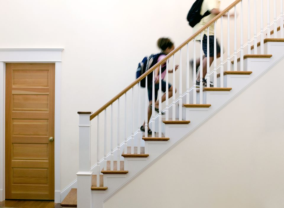 Children running up stairs
