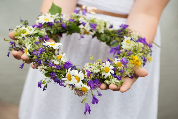 child holding a flower crown