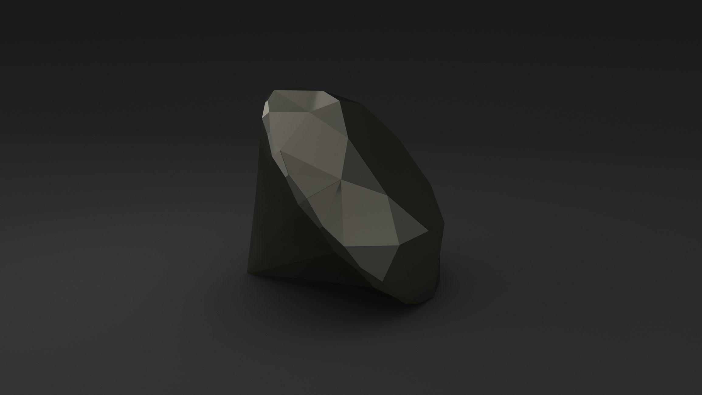 Polished black diamond on a black background