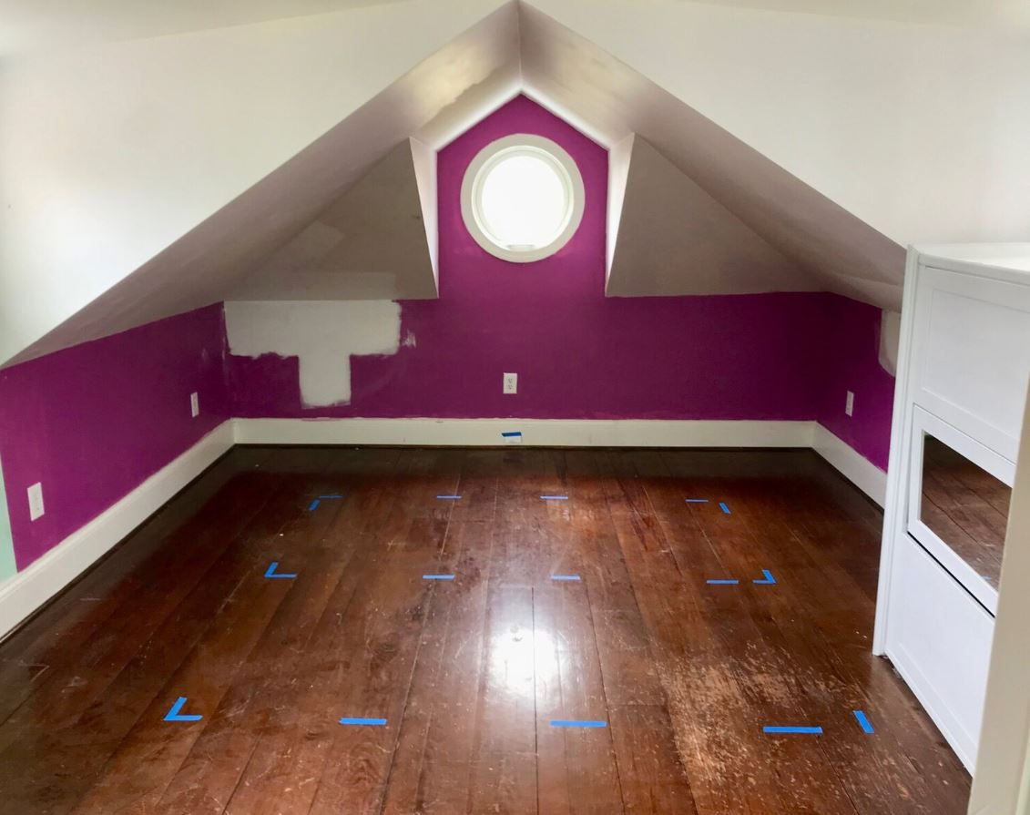 Finished attic space with magenta walls.