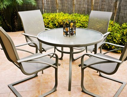 Tile patio with table and chairs.