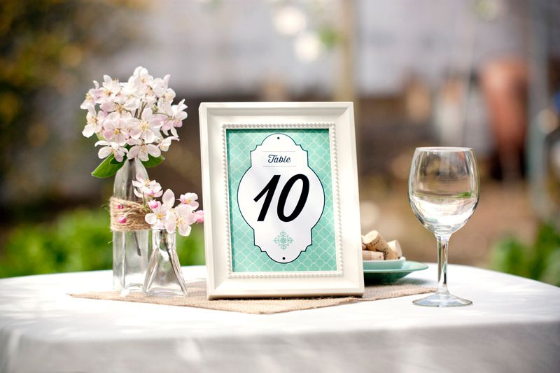 A green wedding table number in a frame