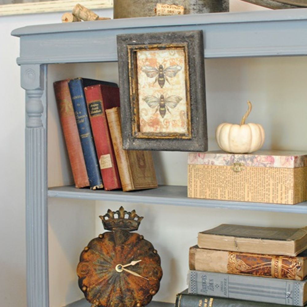 Chalk paint bookcase makeover with a white interior.