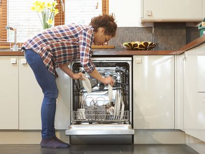 woman filling dishwasher