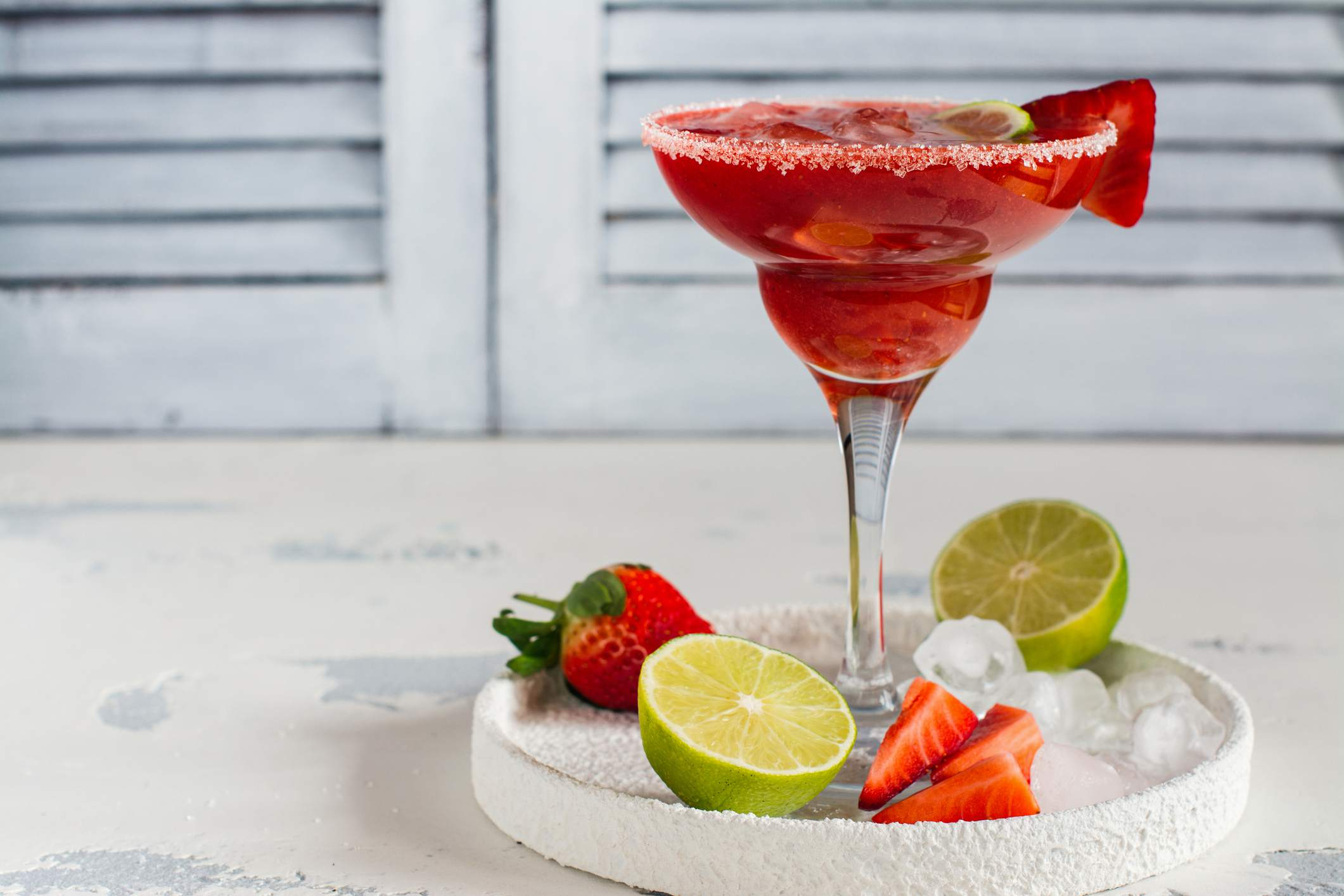 Strawberry and lime daiquiri on serving tray