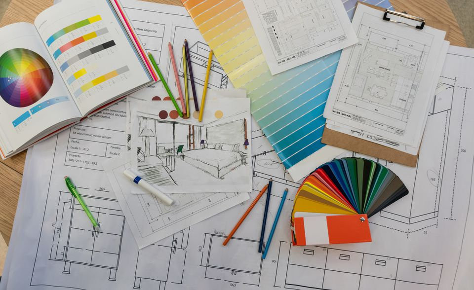 Blue prints, color swatch, pencil colors, sketches, plans and documents for a home renovation