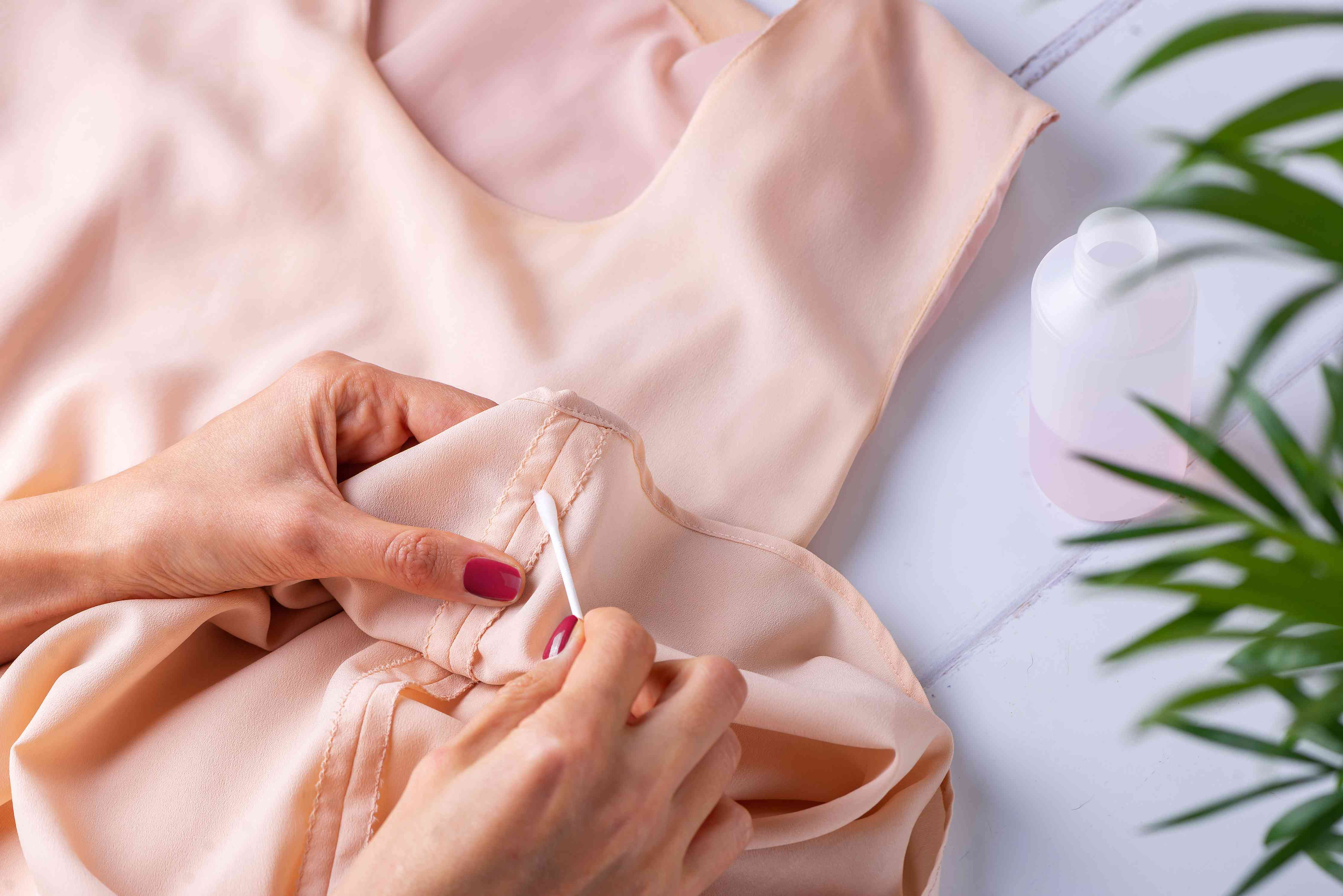 testing acetone on a hidden area of the garment