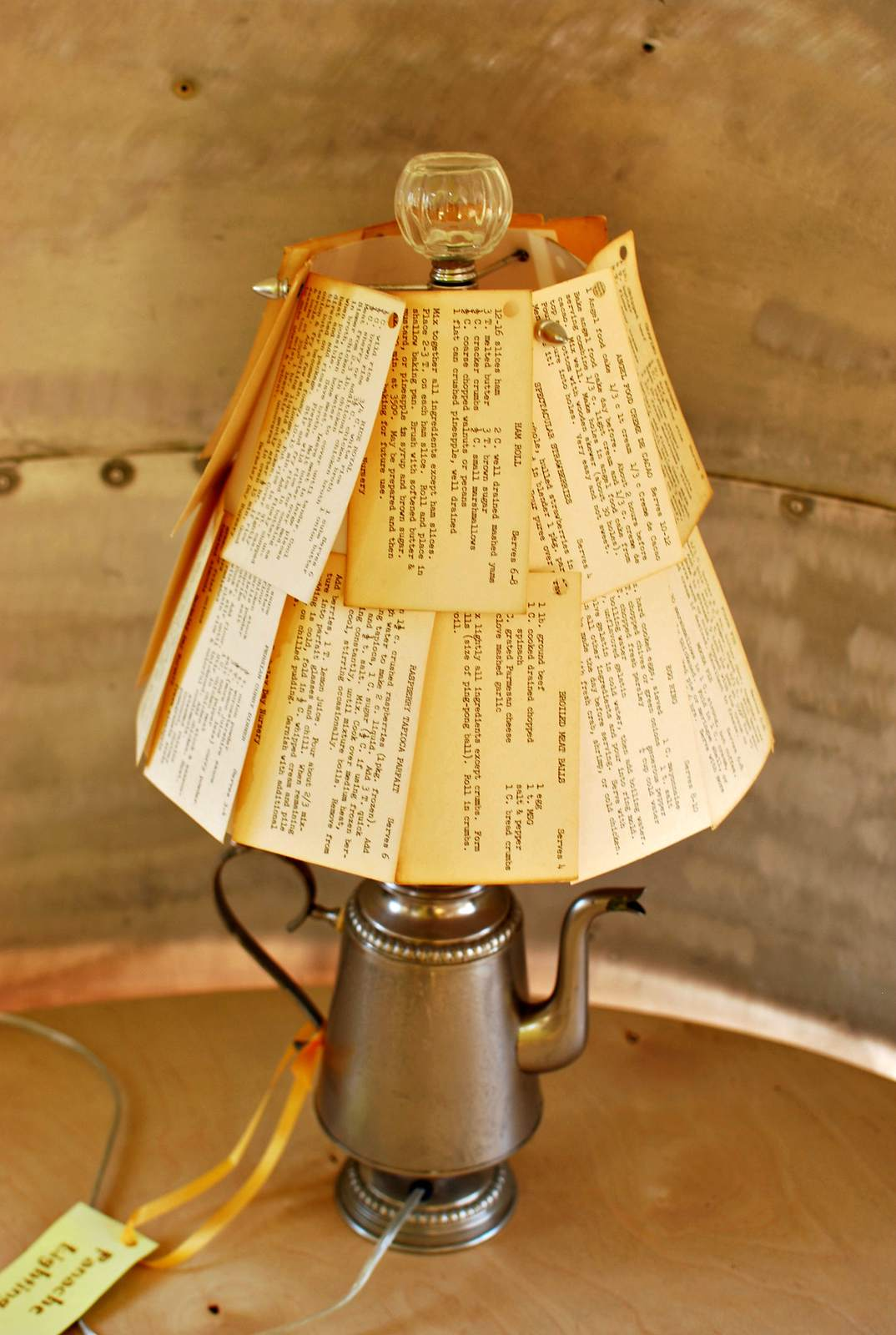 Lamp upcycled from coffeepot and shade made from recipe cards.