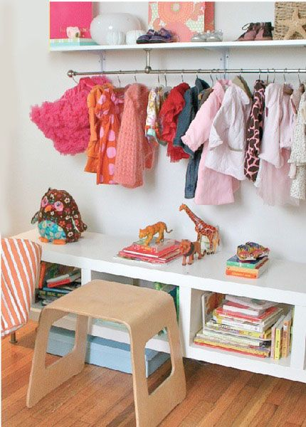 Wall shelf doubles as a closet rack in kid's room