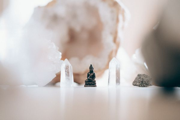 Small buddha statue with white and clear crystals