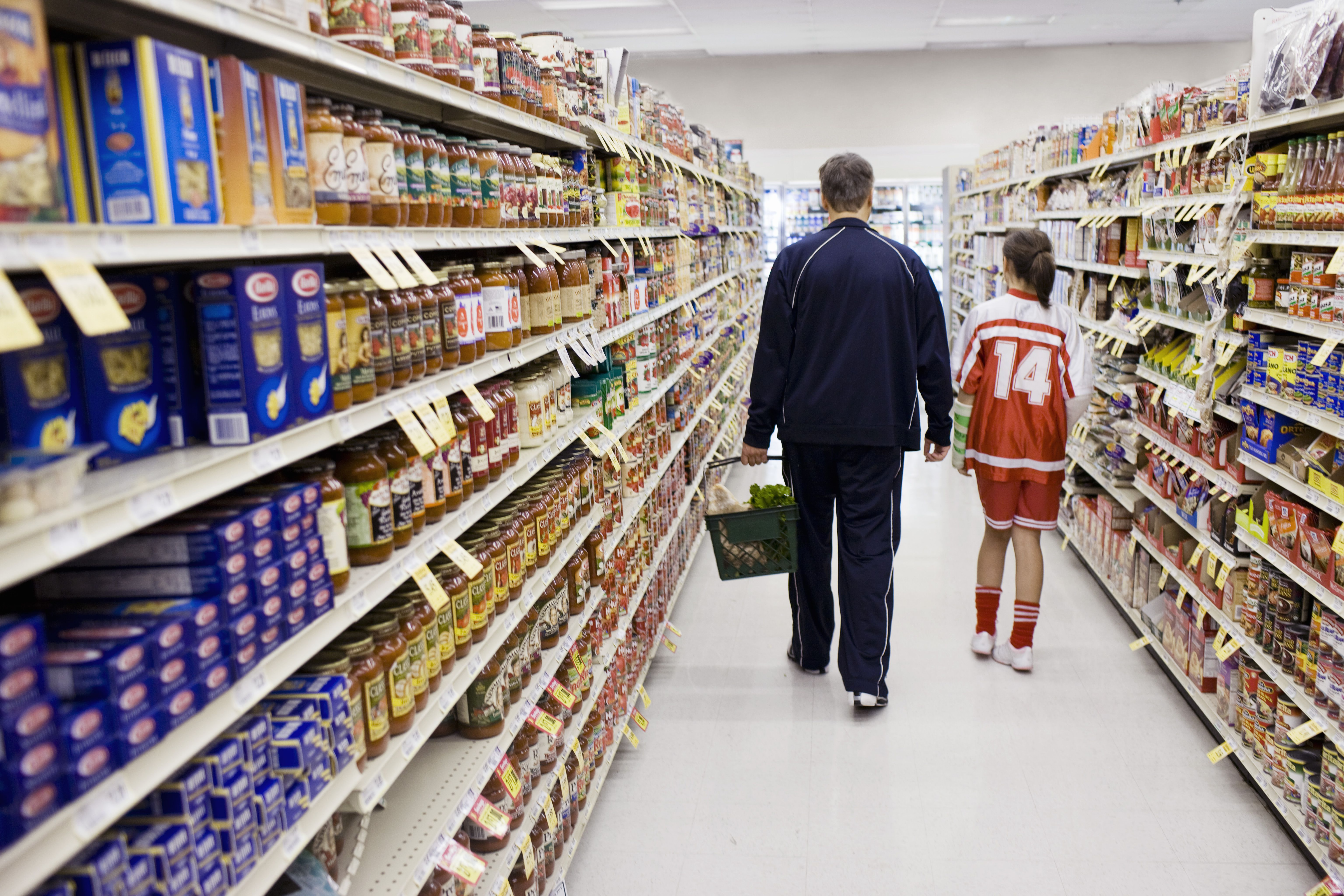 Father and daughter grocery shopping