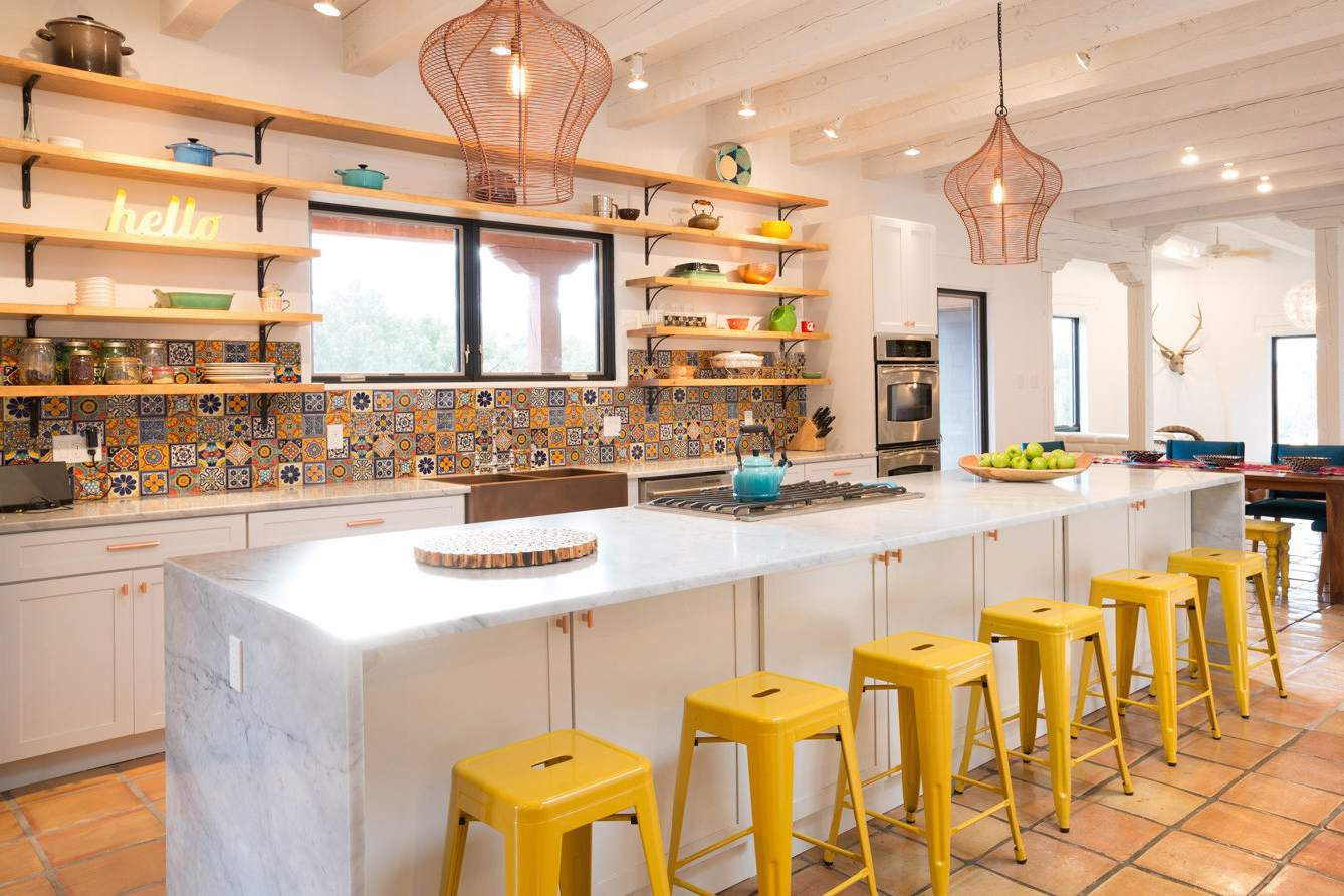 Yellow kitchen with spanish tile