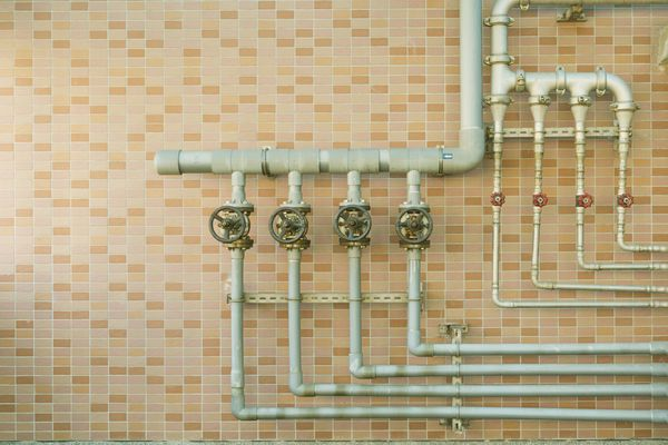water pipes mounted on a brick wall