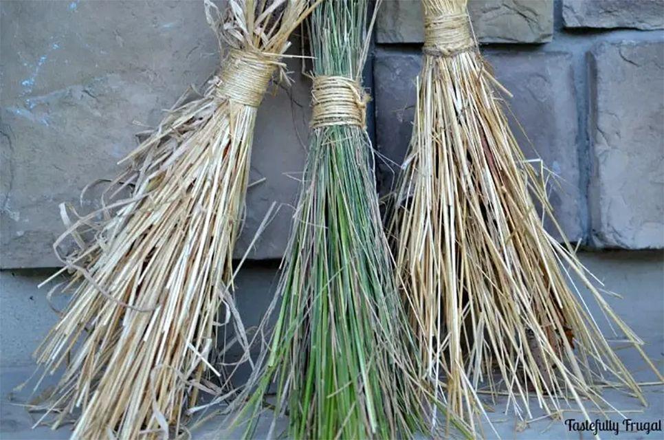 Three handmade brooms