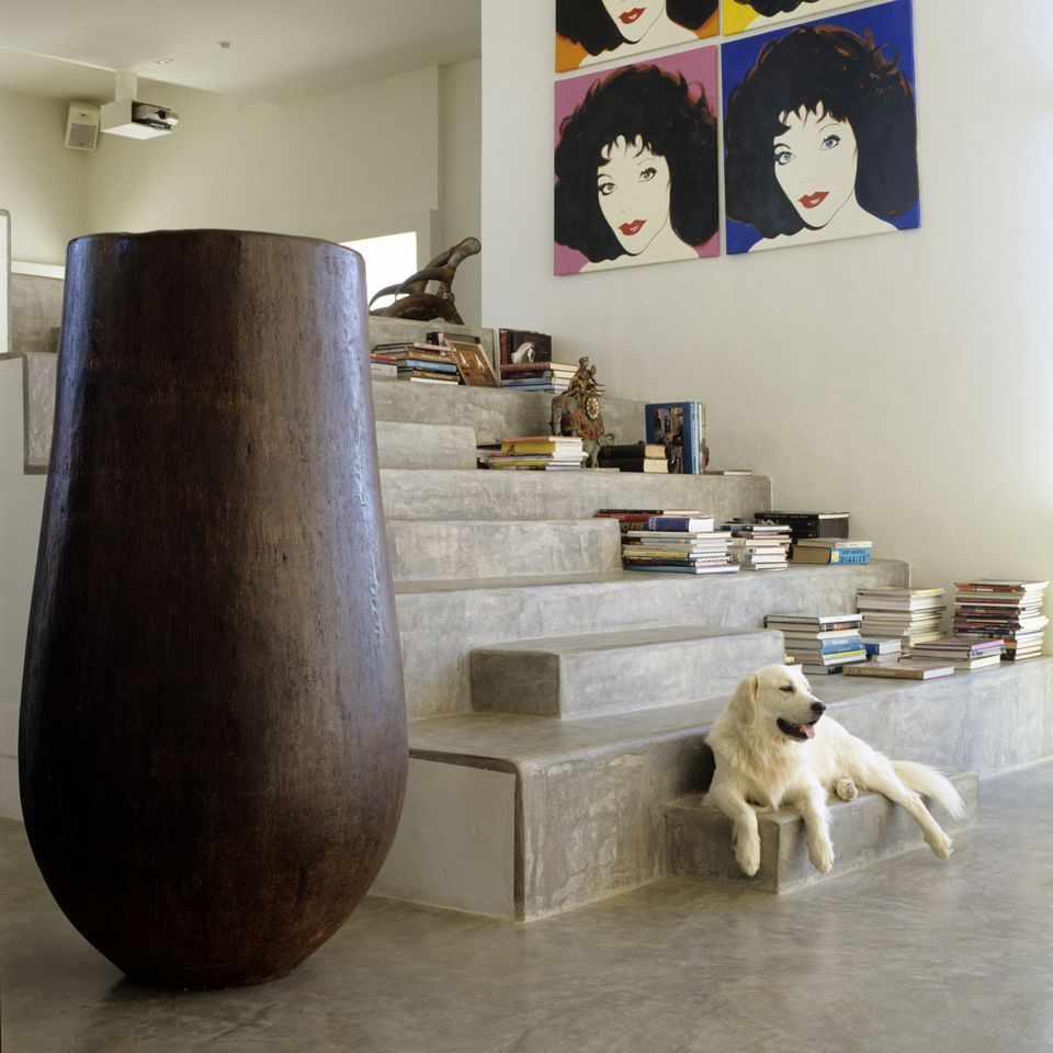 Open-plan Ibizan house renovation with polished concrete flooring and South-east Asian artifacts