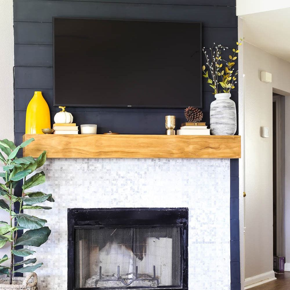 A white fireplace in a living room